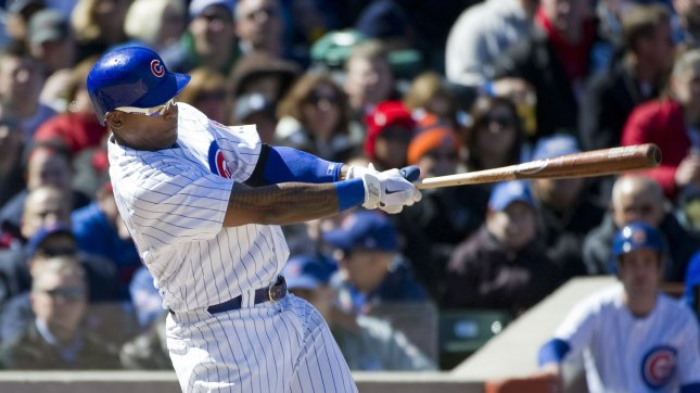 Marlon Byrd follows through on an RBI single for the Chicago Cubs in an April 5, 2012, game in Chicago. UPI/Brian Kersey