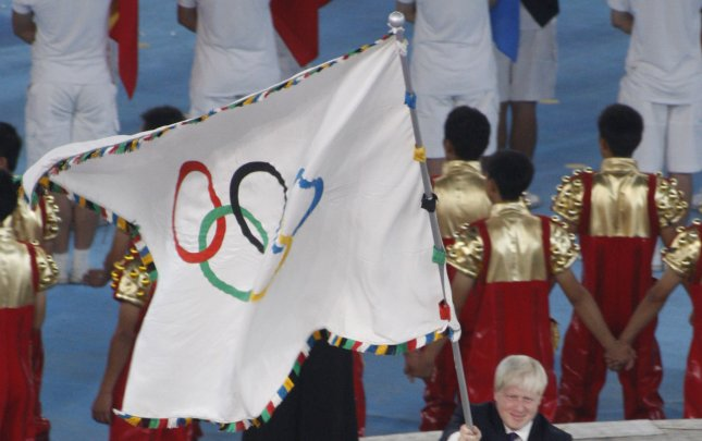 London's Mayor Boris Johnson waves the Olympic flag during the closing ceremonies for the 2008 Summer Olympics at the National Stadium in Beijing on August 23, 2008. (UPI Photo/Terry Schmitt)