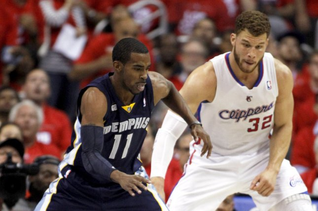 Memphis Grizzlies guard Mike Conley (11) with Clippers forward Blake Griffin (32). UPI/Alex Gallardo