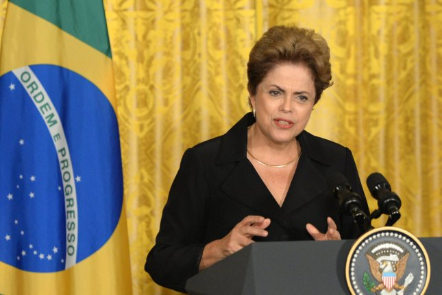 Brazilian President Dilma Rousseff, seen here during a press conference at the White House, may be impeached if the Brazilian Federal Senate votes in a two-thirds majority to remove her from the presidency. The Senate early Wednesday voted in favor of holding an impeachment trial. File Photo by Pat Benic/UPI