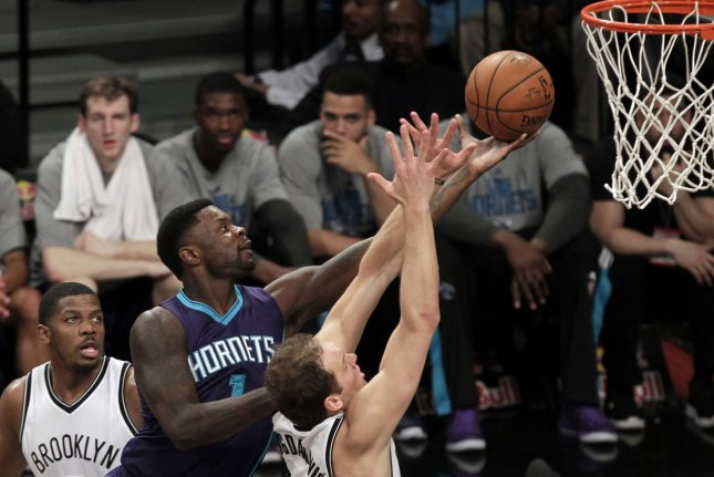 Charlotte Hornets' Lance Stephenson takes a shot under the basket in the first half against the Brooklyn Nets at Barclays Center in New York City on March 4, 2015. Photo by John Angelillo/ UPI