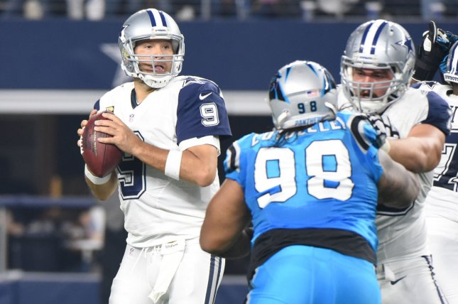 Dallas Cowboys' Tony Romo looks to throw against the Carollna Panthers during the first half at AT&T Stadium on November 26, 2015 in Arlington, Texas. Romo threw three interceptions in the first half. Photo by Ian Halperin/UPI