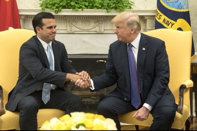 President Donald Trump (R) shakes hands with Gov. Ricardo Rossello of Puerto Rico during a meeting in the Oval Office at the White House on Thursday. Photo by Kevin Dietsch/UPI