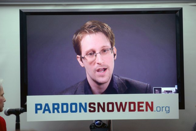 Whistle-blower Edward Snowden speaks at a conference via a monitor at the launch of a campaign in 2016 calling on then-President Barack Obama for a pardon. Snowden revealed the existence of a secret NSA phone surveillance program in 2013, and later a similar effort by the British government. File Photo by Dennis Van Tine/UPI