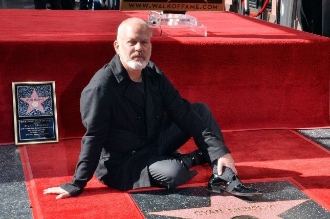 Ryan Murphy, a screenwriter, director, and producer, sits beside his star during an unveiling ceremony honoring him with the 2,652rd star on the Hollywood Walk of Fame in Los Angeles on Tuesday. Photo by Jim Ruymen/UPI