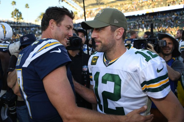 Philip Rivers (L) helped the Los Angeles Chargers hand Aaron Rodgers (R) and the Green Bay Packers their first loss since Sept. 26 with a 26-11 triumph Sunday in Carson, Calif. Photo by Jon SooHoo/UPI