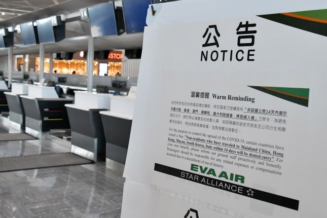 A notice related to the spread of the coronavirus disease is seen Monday posted at Narita International Airport in Chiba prefecture, Japan. Photo by Keizo Mori/UPI