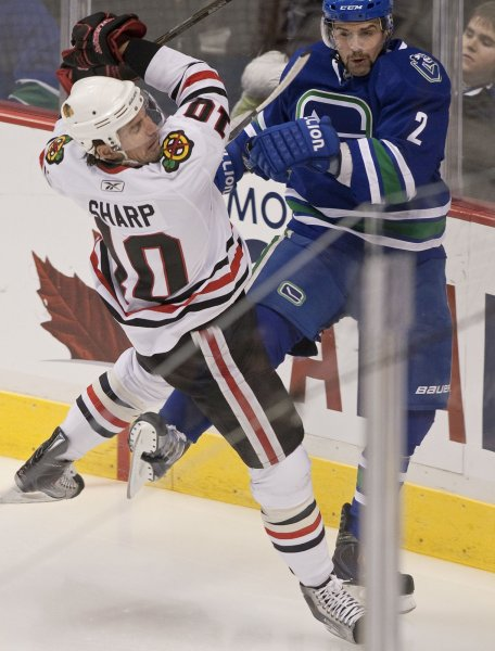 Chicago Blackhawks Patrick Sharp (L.) and Vancouver Canucks Dan Hamhuis clash in the corner during a scoreless first period at Rogers Arena in Vancouver British Columbia on November 20, 2010. The Blackhawks beat the Canucks 7-1. UPI/Heinz Ruckemann