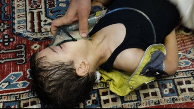 A child, affected by what activists say is nerve gas, breathes through an oxygen mask in Damascus suburbs in Syria, August 21, 2013. Syrian rebels claim hundreds were killed in a toxic gas attack by pro-government forces, and the Syrian government has denied the claims. The UN is investigating. UPI/Diaa El Din