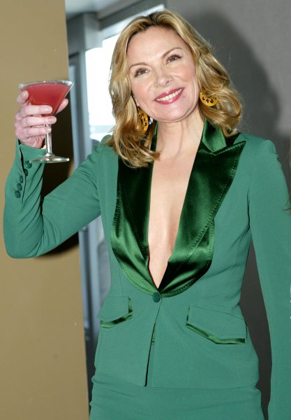 Employees who have sex more often, make more money Kim Cattrall, who plays in Sex and the City, poses with a low calorie cocktail. (UPI Photo/Monika Graff)