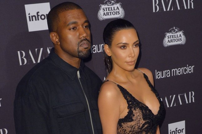 Kim Kardashian (R) and Kanye West at the Harper's Bazaar Icons party on September 9. File Photo by Andrea Hanks/UPI