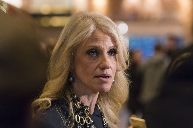 Trump campaign manager Kellyanne Conway speaks to the press in the lobby of Trump Tower on Dec. 15. President-elect Donald Trump is said to be considering her husband, George Conway, for the post of solicitor general. Pool photo by Albin Lohr-Jones/UPI