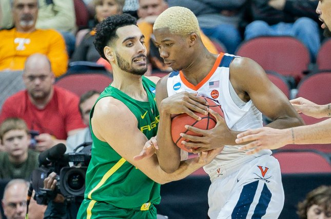 Virginia Cavaliers forward Mamadi Diakite (R) and Oregon Ducks guard Ehab Amin (L) had a physical second half sequence resulting in double technical fouls during their Sweet 16 matchup Thursday in Louisville. Photo by Bryan Woolston/UPI