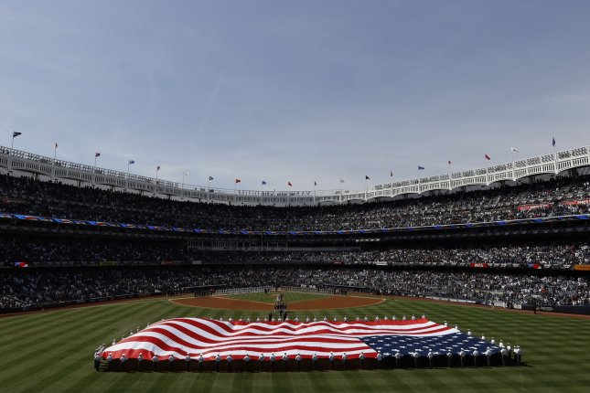 A giant American Flag is unfurled in center field for the national anthem on Opening Day of the 2019 MLB season when the New York Yankees played the Baltimore Orioles at Yankee Stadium in New York City on March 28. Photo by John Angelillo/UPI