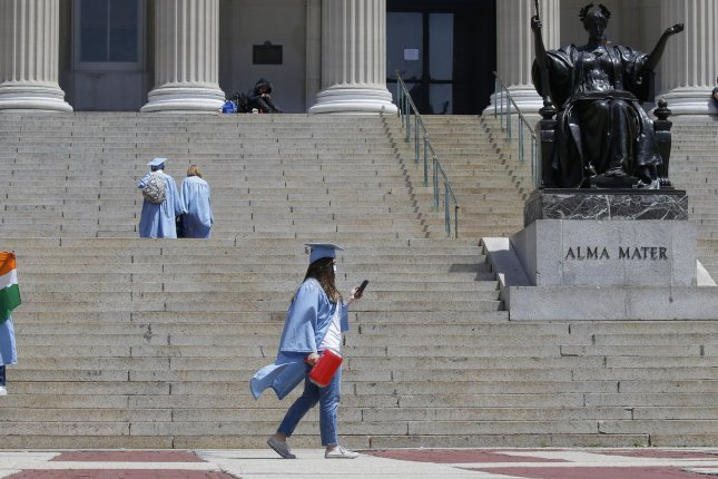 Graduates celebrate on the steps to the Library known as Low Beach after Columbia University held its commencement ceremony for its 266th academic year in New York City in May. Photo by John Angelillo/UPI