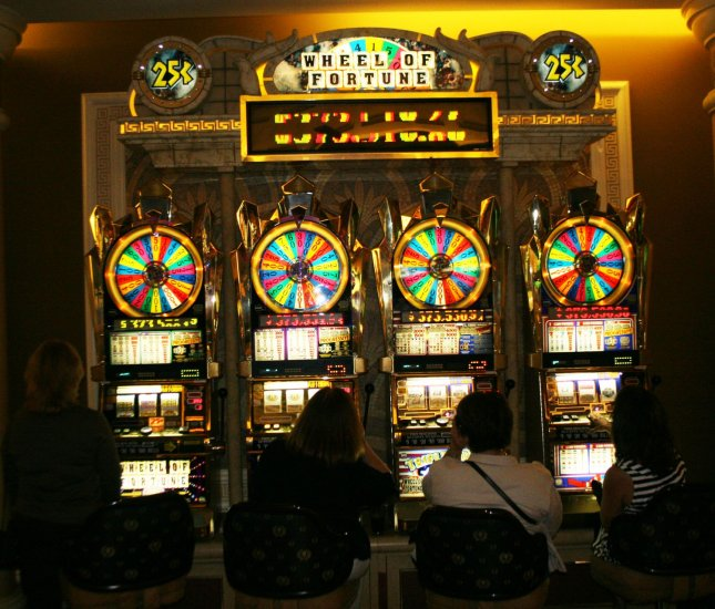 Gamblers from all walks of life enjoy a variety of gaming options. Pictured here are slot machines at Caesars Palace in Las Vegas, Nevada on September 15, 2007. (UPI Photo/Daniel Gluskoter).