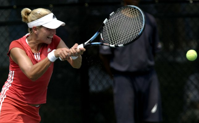Ashley Harkleroad returns the ball to Jennifer Hopkins during the quarterfinals of the Legg Mason Tennis Classic at the William H.G. Fitzgerald Tennis Center in Washington, D.C. on August 5, 2005. (UPI Photo/Kevin Dietsch)