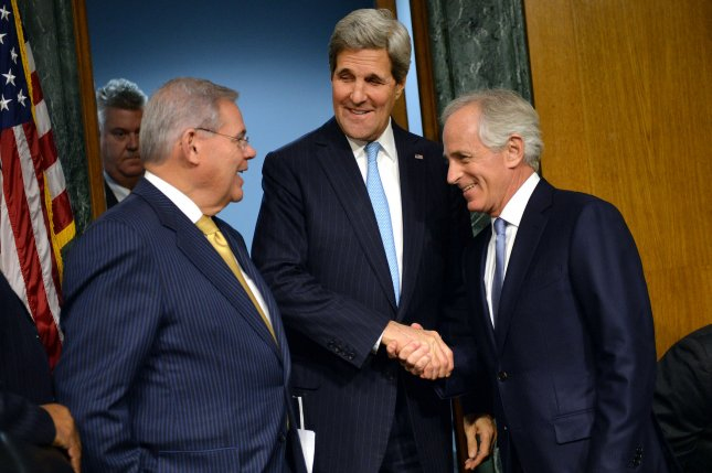 Secretary of State John Kerry talks to Committee Chairman Robert Menendez, D-N.J., (L) and ranking member Sen. Bob Corker, R-Tenn, before testifying during a Senate Foreign Relations Committee hearing on the authorization for the use of military force against ISIL, on Capitol Hill on December 9, 2014 in Washington, D.C. UPI/Kevin Dietsch