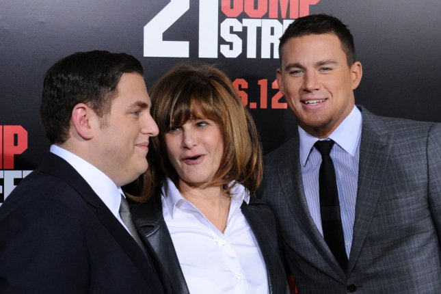 Actors Jonah Hill (L) and Channing Tatum (R), cast members in the motion picture action comedy 21 Jump Street, pose with Co-Chairman of Sony Pictures Entertainment Amy Pascal. UPI/Jim Ruymen