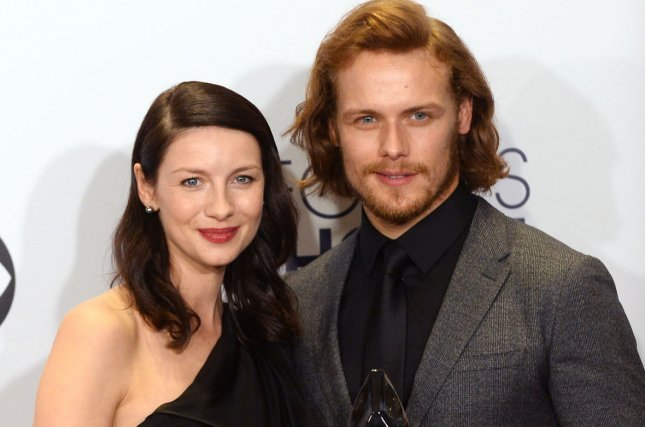 Actors Caitriona Balfe, left, and Sam Heughan pose backstage with the award for favorite cable sci-fi/fantasy TV show for Outlander at the 41st annual People's Choice Awards in Los Angeles on January 7, 2015. File photo by Jim Ruymen/UPI