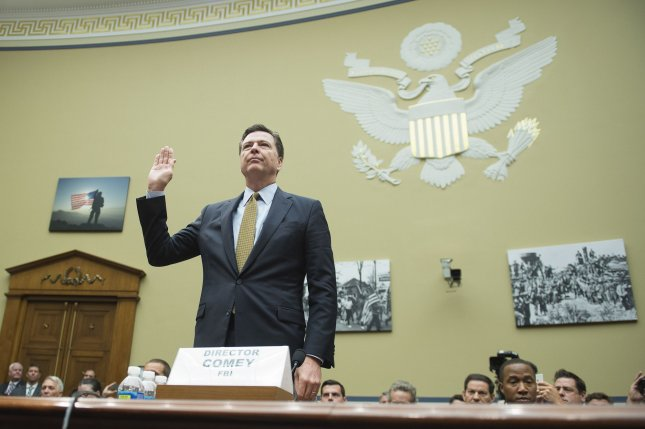 FBI Director James Comey is sworn in before testifying at a House Oversight and Government Reform Committee hearing on the investigation into Hillary Clinton's use of a private email account while serving as secretary of state, in Washington, D.C., on July 7. Comey said the investigation concluded that no charges were warranted in the case, and made the same determination in early November after his highly controversial decision to announce a look at potential new evidence on the laptop of an aide's husband -- a move Clinton supporters say ultimately cost the former first lady the election. File Photo by Kevin Dietsch/UPI