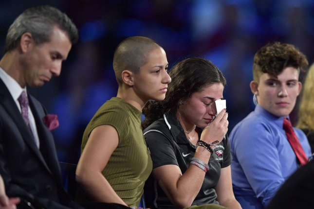 Marjory Stoneman Douglas High School student Emma Gonzalez (C) comforts a classmate during a CNN town hall meeting on February 21 after the mass shooting at their school. Pool Photo by Michael Laughlin/UPI