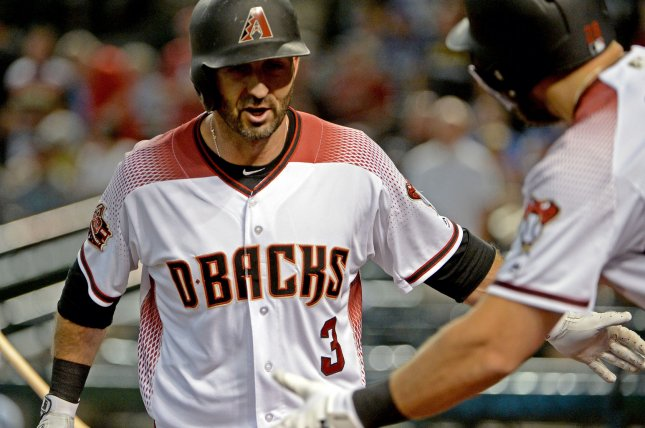 Arizona Diamondbacks' Daniel Descalso is congratulated after hitting a two run home run in the first inning against the Milwaukee Brewers on May 16 at Chase Field in Phoenix, Ariz. Photo by Art Foxall/UPI