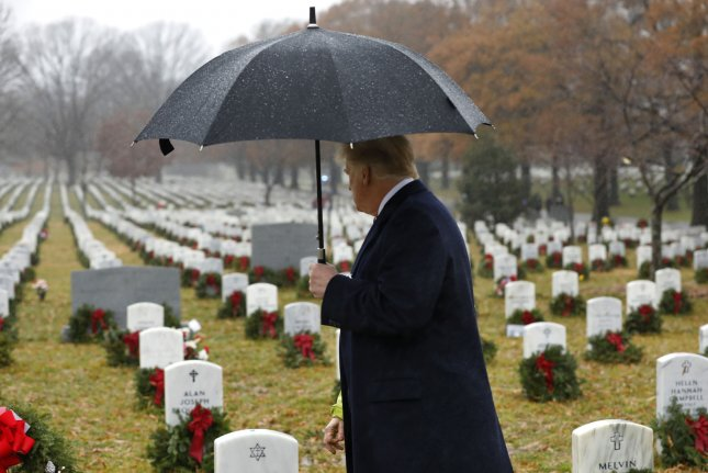 President Donald Trump on Saturday visits Section 60, where military personnel killed in the Global War on Terror since 2001 are interred at Arlington National Cemetery in Arlington, Va. Photo by Yuri Gripas/UPI