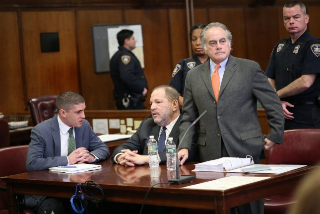 Film producer Harvey Weinstein (center) hired a new legal team as he prepares to defend against five felony sexual assault charges this May. Pool photo by Alec Tabak/UPI
