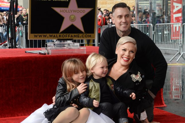 Pink (C) is joined by, left to right, her daughter Willow Sage Hart, son Jameson Moon Hart and her husband Carey Hart. Pink's kids gave her a tinfoil Grammy award after she lost during Sunday's Grammy Awards. Photo by Jim Ruymen/UPI.