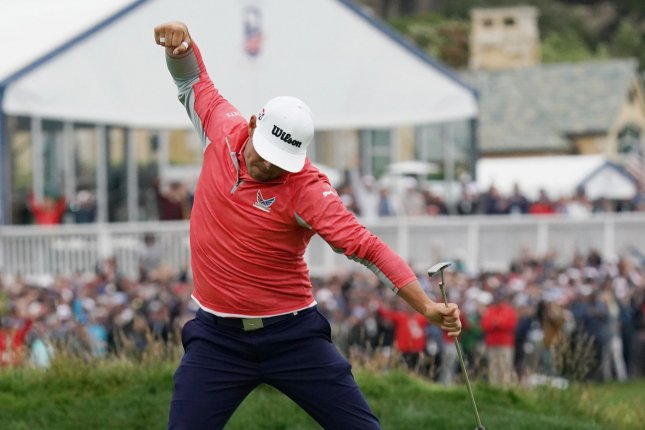Gary Woodland celebrates on the 18th green in the final round of the 2019 U.S. Open on Sunday at Pebble Beach Golf Links in Pebble Beach, California. Gary Woodland wins the 2019 U.S. Open and his first major championship with a score of 13-under par. Photo by Kevin Dietsch/UPI