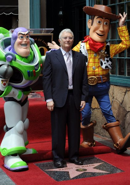 Singer, composer and songwriter Randy Newman is joined by Buzz Lightyear and Woody of Disney Pixar's Toy Story 3 during an unveiling ceremony honoring him with the 2,411th star on the Hollywood Walk of Fame in front of the historic Musso & Frank Grill in Los Angeles on June 2, 2010. UPI/Jim Ruymen