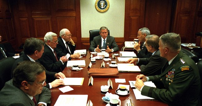 U.S. President George W. Bush speaks at one of his many meetings with his national security advisers in the Situation Room of the White House in the days after the Sept. 11, 2001, terrorist attacks on the United States. Bush said on Sept. 17 al-Qaida's Osama bin Laden was wanted dead or alive for the attacks. White House Photo/Eric Draper/UPI File