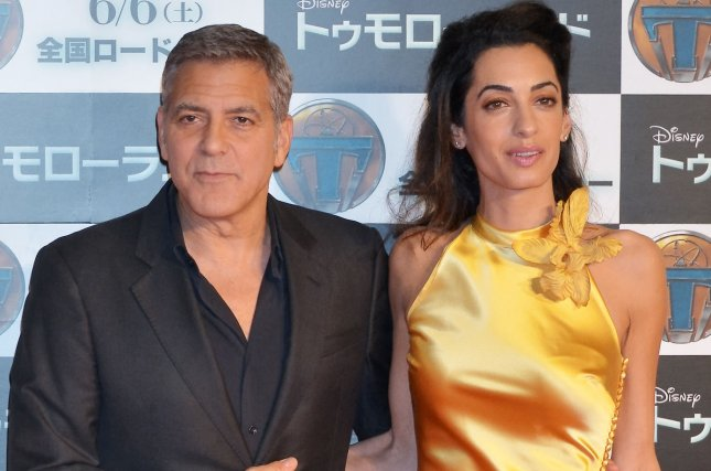 Actor George Clooney and his wife Amal attend a Japan premiere for the film Tomorrowland in Tokyo, Japan on May 25, 2015. The couple celebrated their first anniversary over the weekend. File Photo by Keizo Mori/UPI