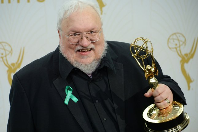 Writer George R. R. Martin, winner of Outstanding Drama Series for Game of Thrones holds his Emmy at the 67th Primetime Emmy Awards on September 20. A new Game of Thrones short story from Martin will explore the Targaryen family. File Photo by Jim Ruymen/UPI