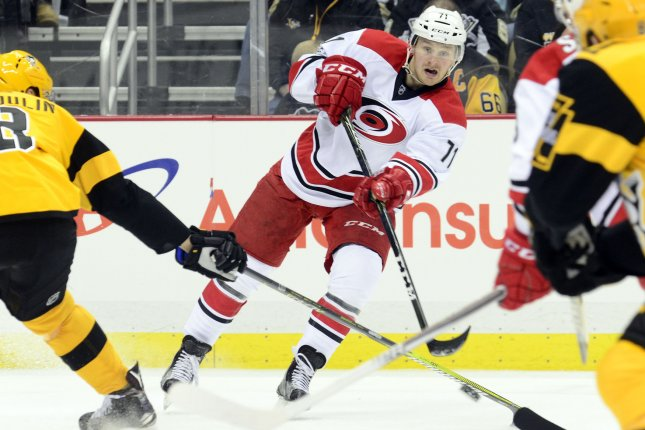 Carolina Hurricanes forward Lucas Wallmark passes the puck across the ice against the Pittsburgh Penguins in the third period on April 2, 2017 at PPG Paints Arena in Pittsburgh. Wallmark had a goal and the Hurricanes beat the Predators on Sunday afternoon. File photo by Archie Carpenter/UPI