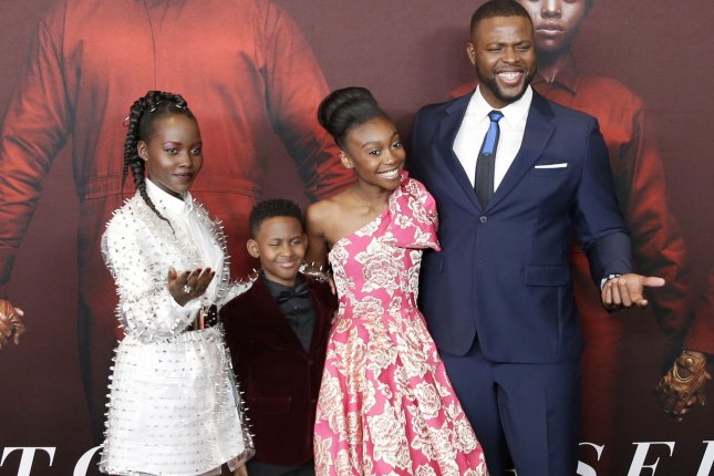 Left to right, Us cast-mates Lupita Nyong'o, Evan Alex, Shahadi Wright Joseph and Winston Duke arrive at the premiere of the film on Tuesday in New York City. Photo by John Angelillo/UPI