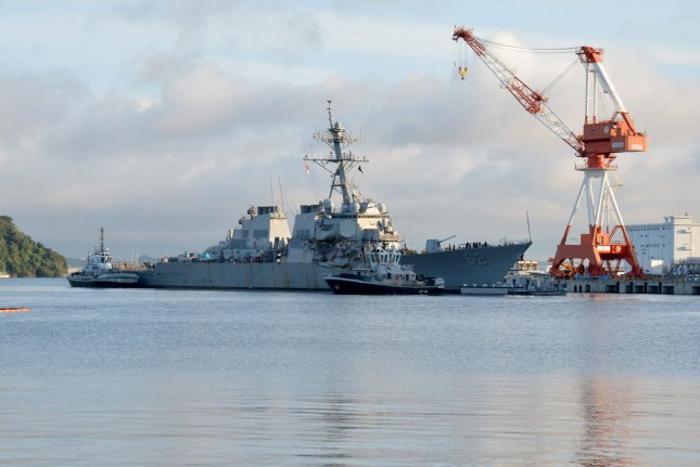 Tugboats assist the Arleigh Burke-class guided-missile destroyer USS Fitzgerald as it moved into dry dock on July 11, 2017. The damaged ship underwent repairs and returned to the sea for testing on Monday. File Photo by MC1 Peter Burghart/U.S. Navy/UPI