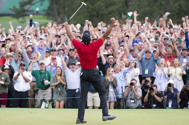 Tiger Woods celebrates on the 18th green after the final round at the 2019 Masters Tournament at Augusta National Golf Club in Augusta, Ga., on April 14, 2019. It was his first major tournament victory since 2008. File Photo by John Angelillo/UPI