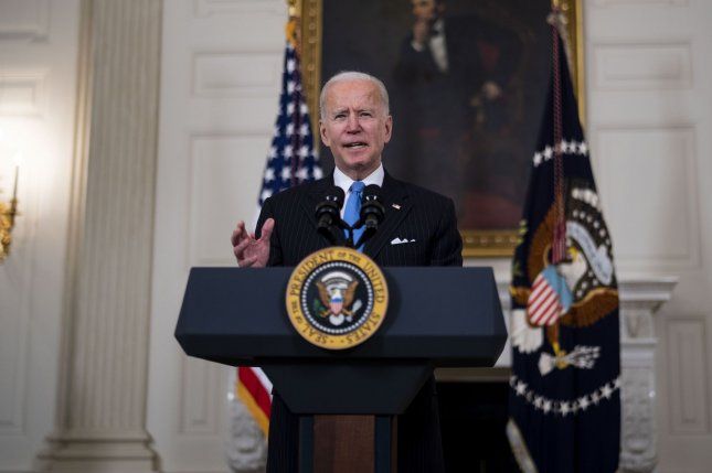 President Joe Biden delivers remarks on the ongoing COVID-19 pandemic in the State Dining Room of the White House on Tuesday. Pool Photo by Doug Mills/UPI