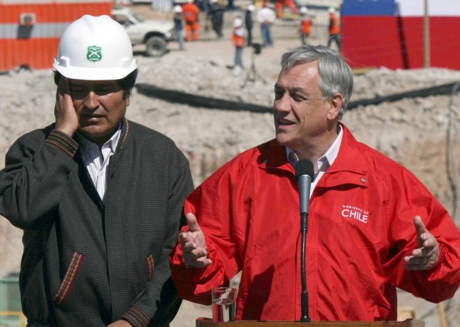 Chilean President Sebastian Pinera (R) and Bolivian President Evo Morales speak to reporters after talking with Carlos Mamani, one of the miners rescued from the San Jose Mine near Copiapo, Chile on October 13, 2010. An accident trapped 33 miners for more than two months more than 2,000 feet below the surface. UPI/Sebastian Padilla