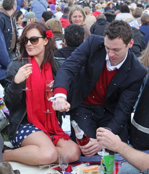 A young British couple enjoys a glass of champagne in Hyde Park in London on April 29, 2011. UPI/David Silpa