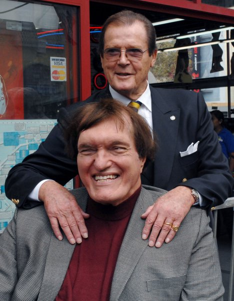 British actor Roger Moore (R) who played the part of James Bond 007 in seven films, poses with actor Richard Kiel who played the role of Jaws in The Spy Who Loved Me, following a ceremony honoring Moore with the 2,350th star on the Hollywood Walk of Fame in Los Angeles on October 11, 2007. Moore appeared in 1973 in his first James Bond film Live and Let Die. He also starred as Simon Templar in the TV series The Saint. (UPI Photo/Jim Ruymen)