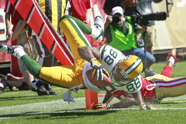 Green Bay Packers TE Jermichael Finley (88) flies into the end zone with a 12 yard pass from Aaron Rodgers as San Francisco 49ers Ray McDonald knocks him off his feet in the second quarter. In Sunday night's game, Finley injured his neck and remains in the ICU for treatment. UPI/Bruce Gordon