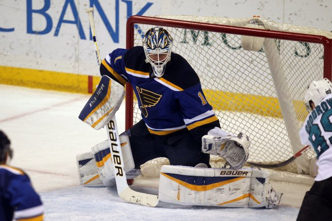 St. Louis Blues goaltender Brian Elliott makes a glove save in the third period against the San Jose Sharks at the Scottrade Center in St. Louis on January 8, 2015. St. Louis defeated San Jose 7-2. Photo by Bill Greenblatt/UPI