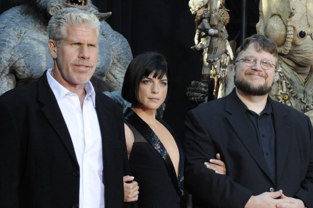 Director Guillermo del Toro (R) and cast members Selma Blair (C) and Ron Perlman appear with characters from the motion picture sci-fi comedy Hellboy II: The Golden Army, during the premiere of the film in Los Angeles on June 28, 2008. Ron Perlman wants Hellboy III and has possibly hinted that we might get it (UPI Photo/Jim Ruymen)