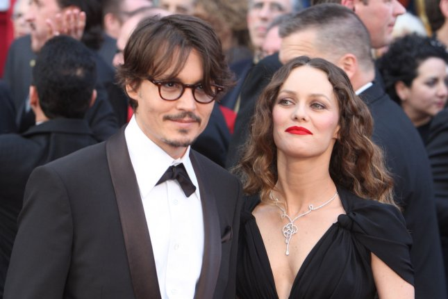 Johnny Depp (L) and Vanessa Paradis at the Academy Awards on February 24, 2008. The former couple's daughter, Lily-Rose Depp, revealed she falls on the LGBTQ spectrum over the weekend. File photo by Terry Schmitt/UPI