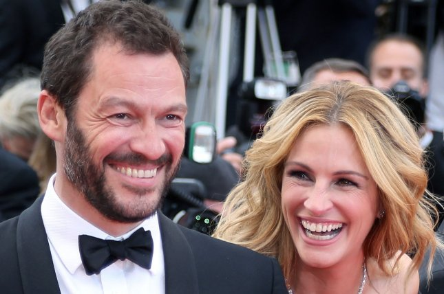 Dominic West (L) and Julia Roberts arrive on the red carpet before the screening of the film Money Monster at the opening of the 69th annual Cannes International Film Festival on May 12. West will next be starring alongside Alicia Vikander in Warner Bros. and MGM's upcoming reboot of Tomb Raider. File Photo by David Silpa/UPI