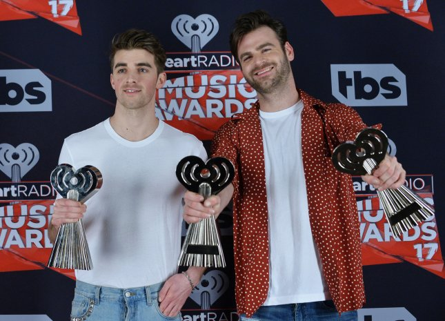 Recording artists Andrew Taggart (L) and Alex Pall of music group The Chainsmokers, winners of the Best New Artist award, Dance Song of the Year award for Closer, and Best New Pop Artist award appear backstage during the iHeartRadio Music Awards on March 5. Photo by Jim Ruymen/UPI