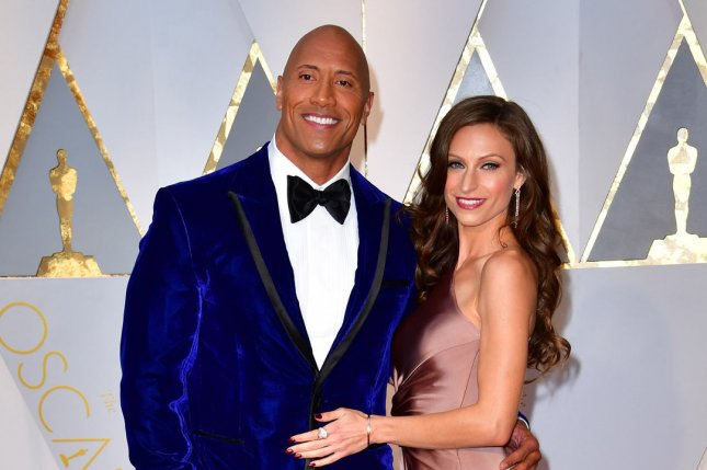 Dwayne Johnson (L) and Lauren Hashian arrive on the red carpet for the 89th annual Academy Awards on February 26. Johnson stars alongside Zac Efron and Priyanka Chopra in the newest trailer for Baywatch. File Photo by Kevin Dietsch/UPI